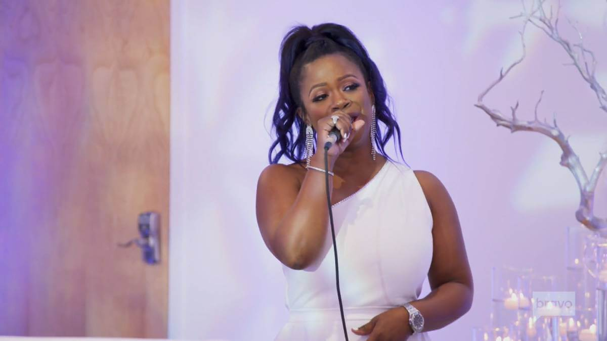 Kandi Burruss sings at Cynthia Bailey's engagement party.