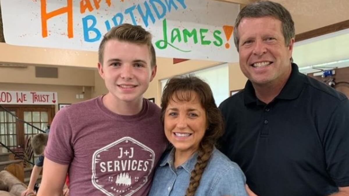 James Duggar with is parents Jim Bob and Michelle Duggar.