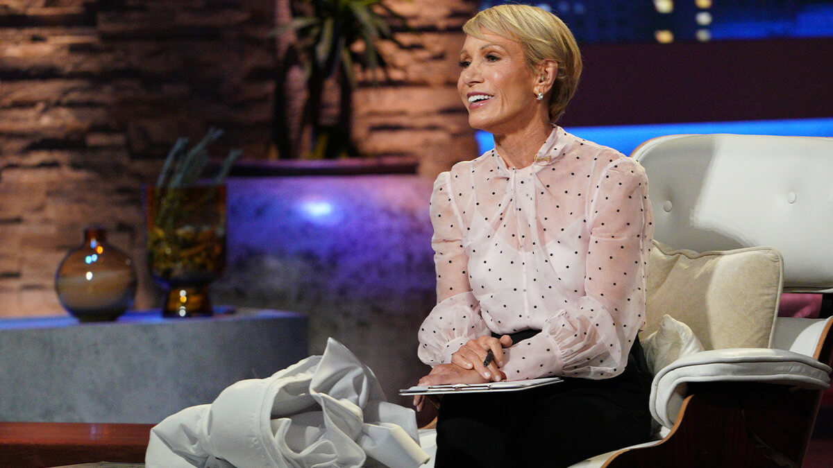Shark Tank investor Barbara Corcoran with her sample Better Bedder sheet.