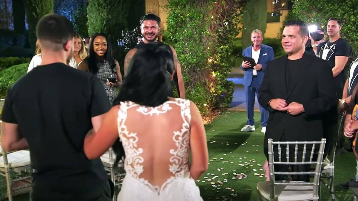 Angela and Chris face their wedding guests.