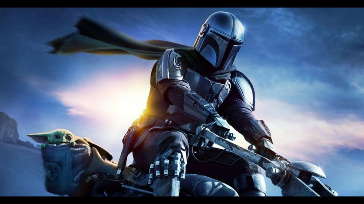 The Mandalorian rides a speederbike with Grogu