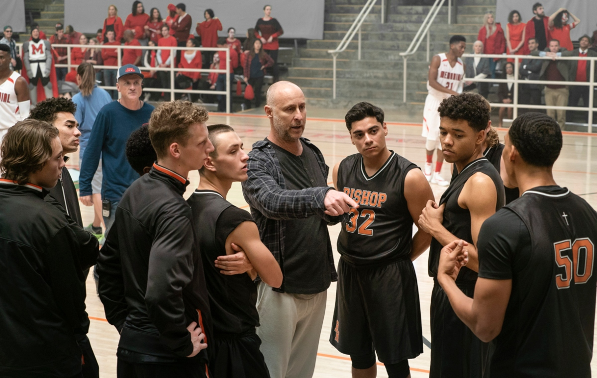 The Way Back director Gavin O'Connor surrounded by the movie's high school basketball team. Pic credit: Warner Bros. Pictures