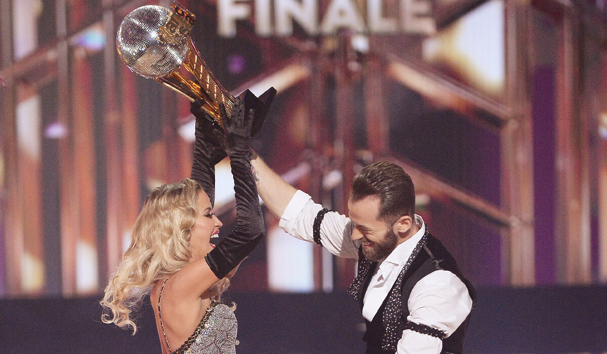 Bristowe and her dance partner Artem with their very own Mirror Ball trophy!