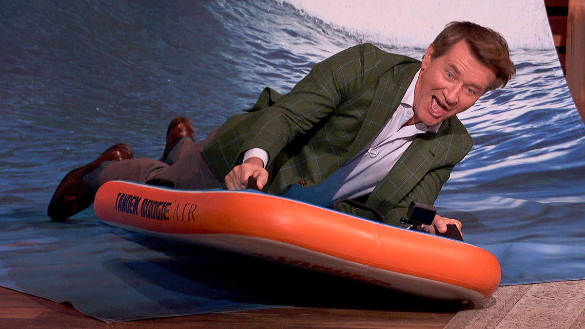 Robert Herjavec riding a Tendem Boogie board.