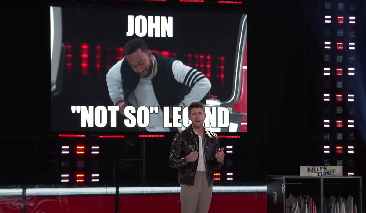 Nick Jonas presenting the meme he created of fellow coach John Legend