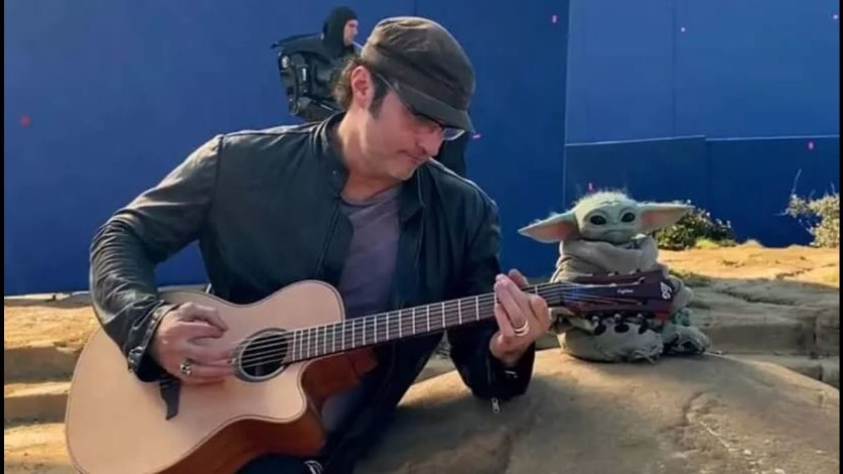 Robert Rodriguez plays the guitar