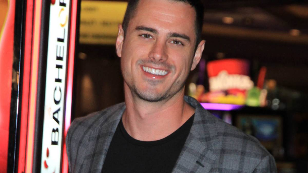 Ben Higgins poses by a slot machine