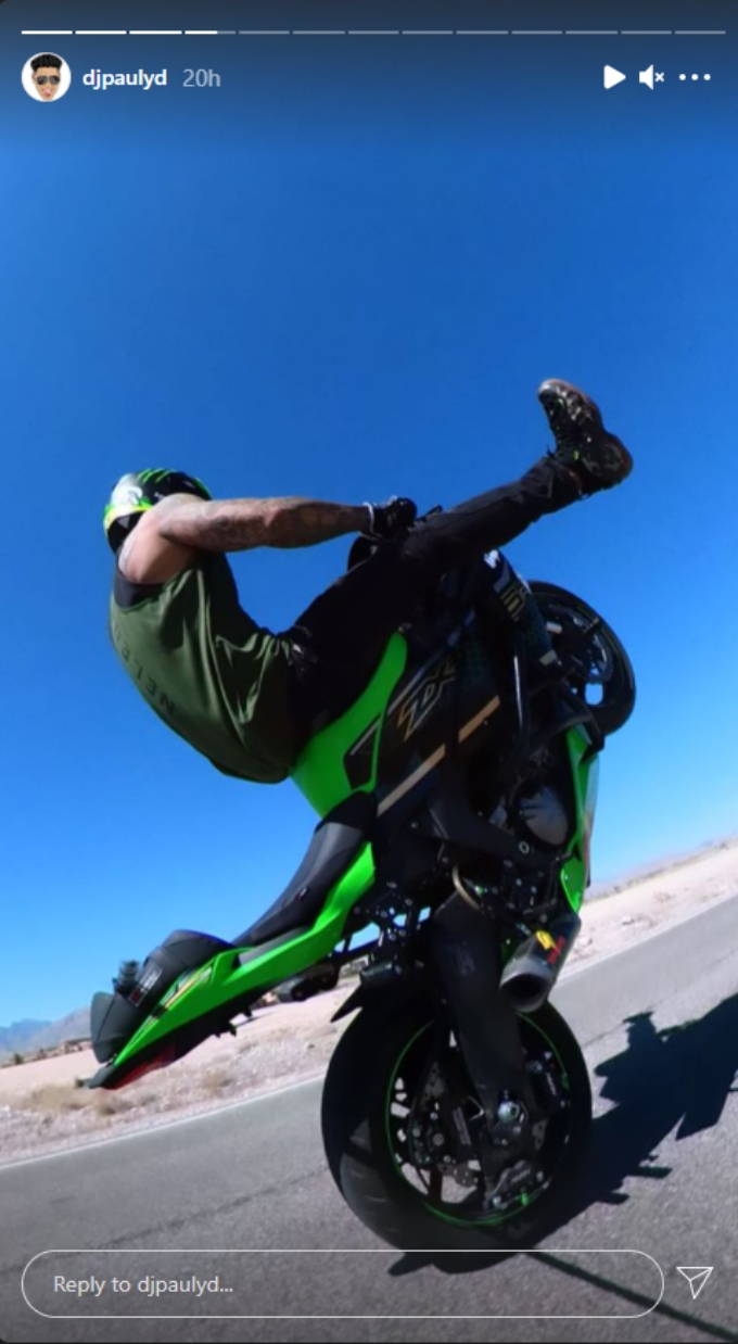 Pauly D performs stunts on his motorcycle on Easter Sunday