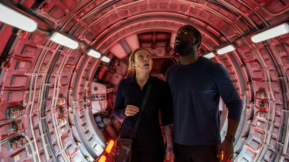 Toni Collette and Shamier Anderson in Stowaway.