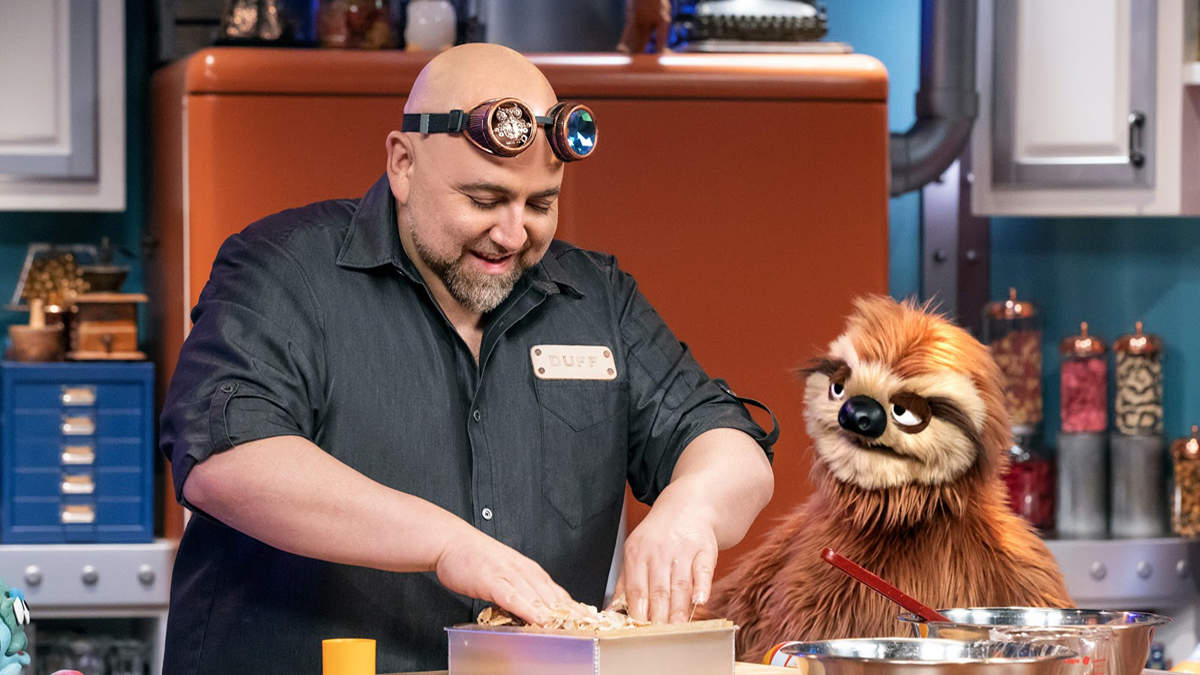 Duff Goldman and S'Later, the sloth, on Duff's Happy Fun Bake Time