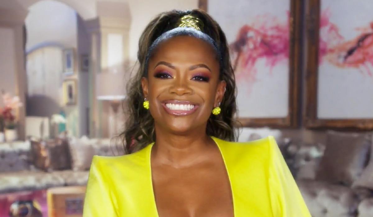 Kandi smiling through the last episode of RHOA