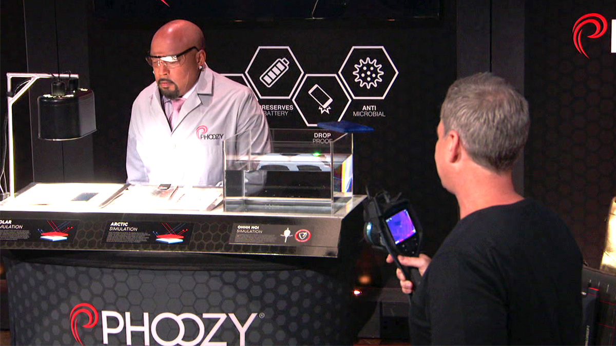 The founders of Phoozy giving Shark Daymond John a product demonstration.