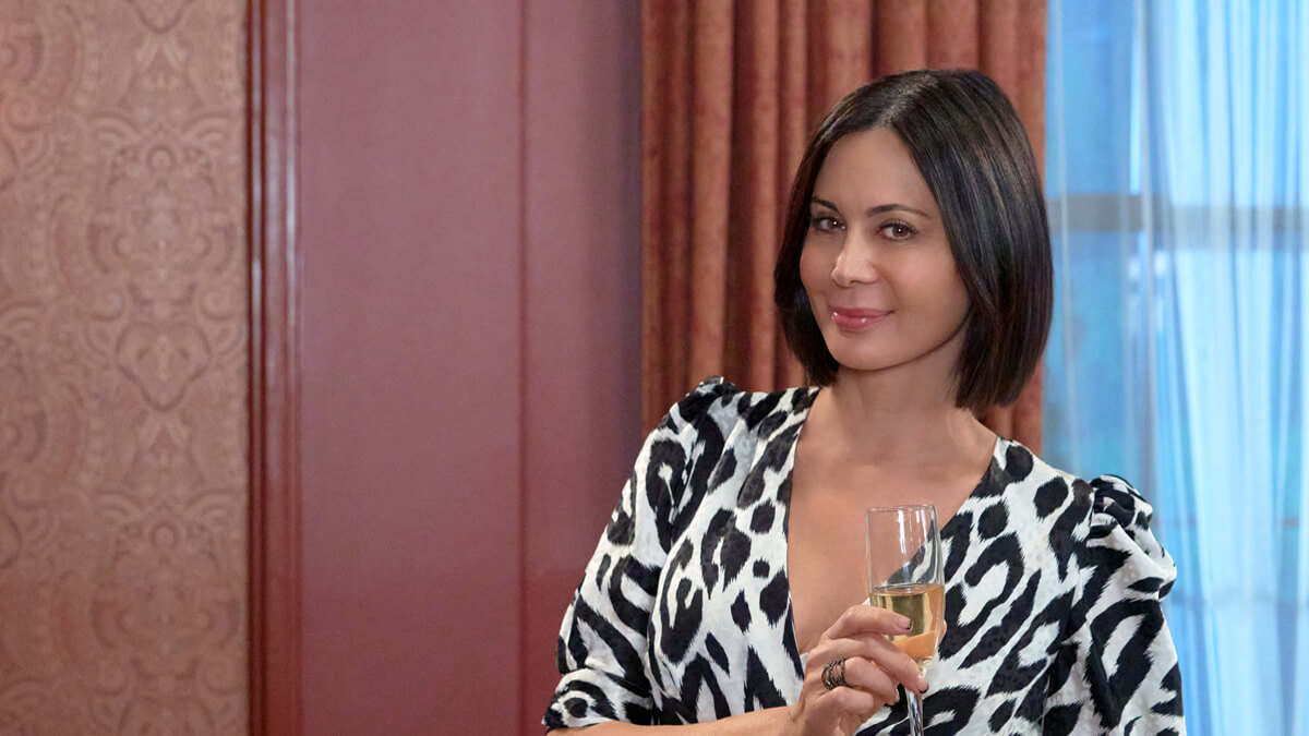 Catherine Bell poses with a glass of wine