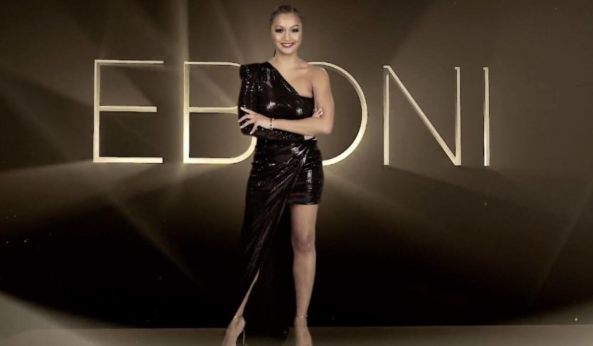 Eboni joins the returning Housewives in a stunning dark dress on the Season 13 opening credits.