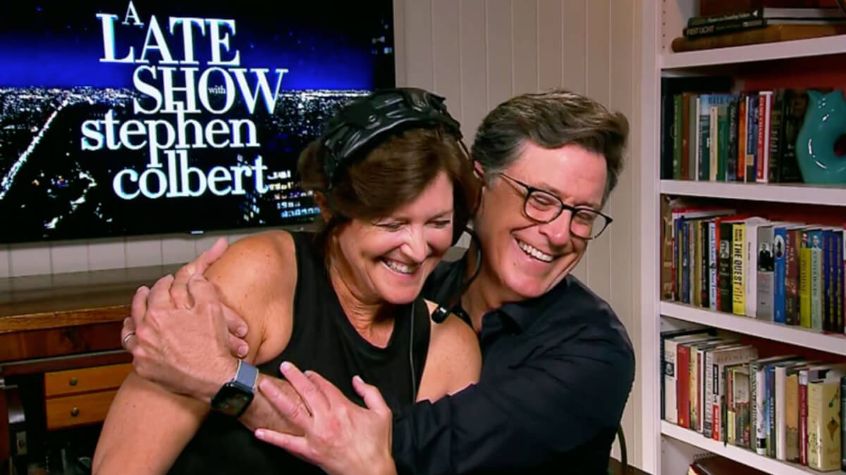 Evie and Stephen Colbert share an on-screen embrace