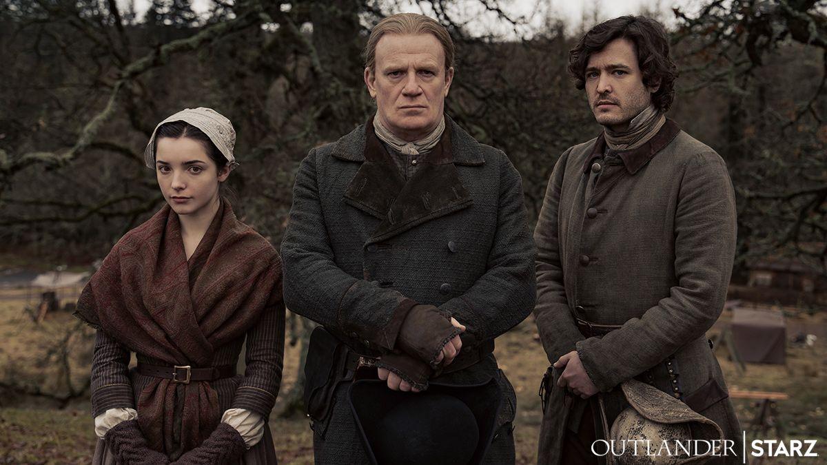 Jessica Reynolds as Malva, Mark Lewis Jones as Tom, and Alexander Vlahos as Allan, as seen in Season 6 of Starz's Outlander