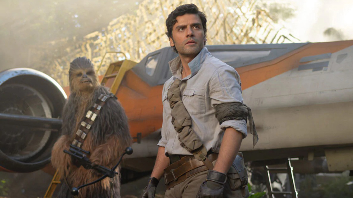Poe Dameron with Chewbacca beside his X-Wing fighter