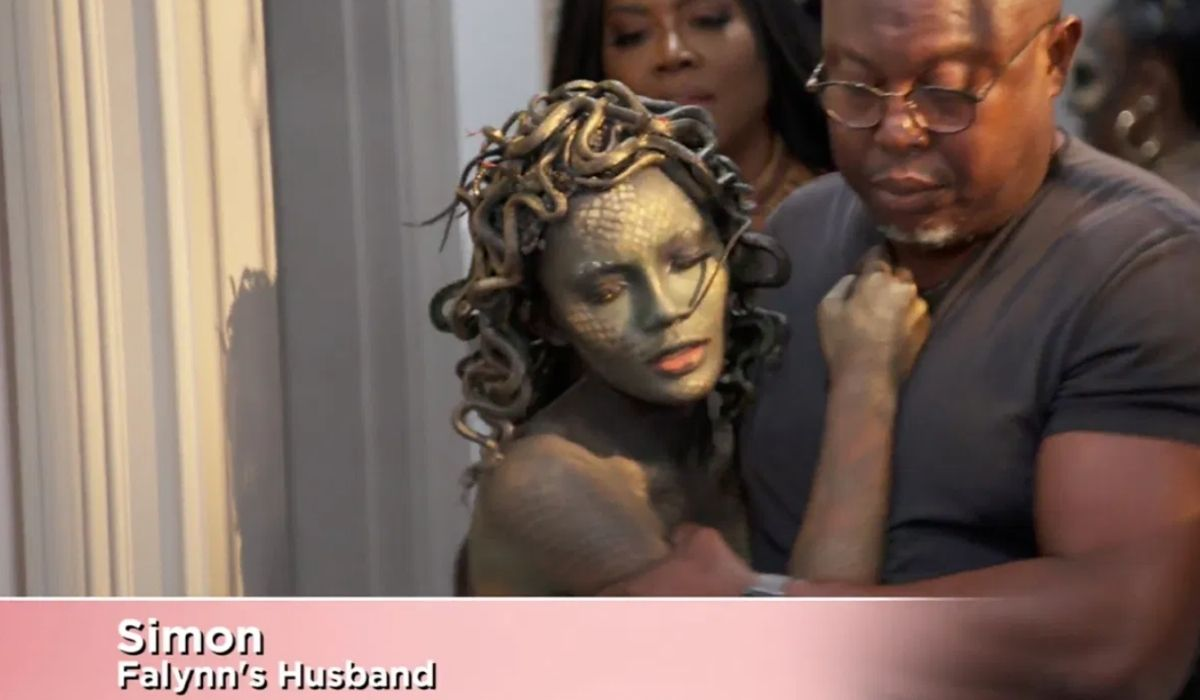 Simon Guobadia calming his wife after an argument with LaToya Ali during her Halloween party.