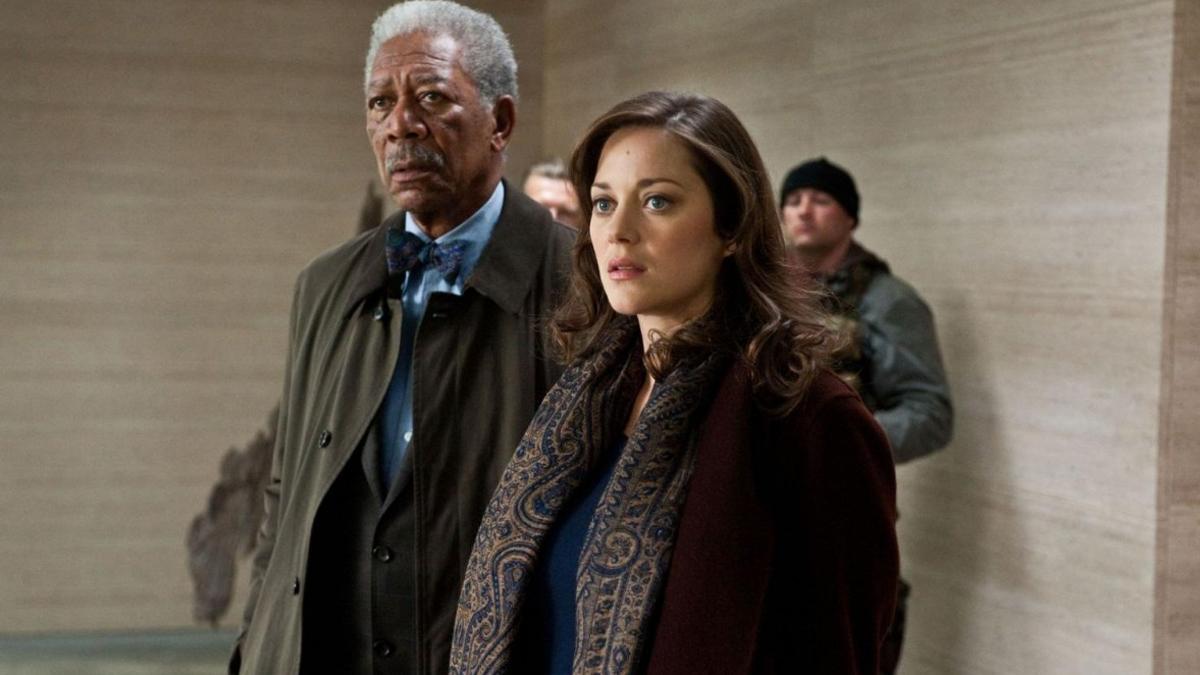 Talia al Ghul standing with Lucius Fox in Dark Knight Rises
