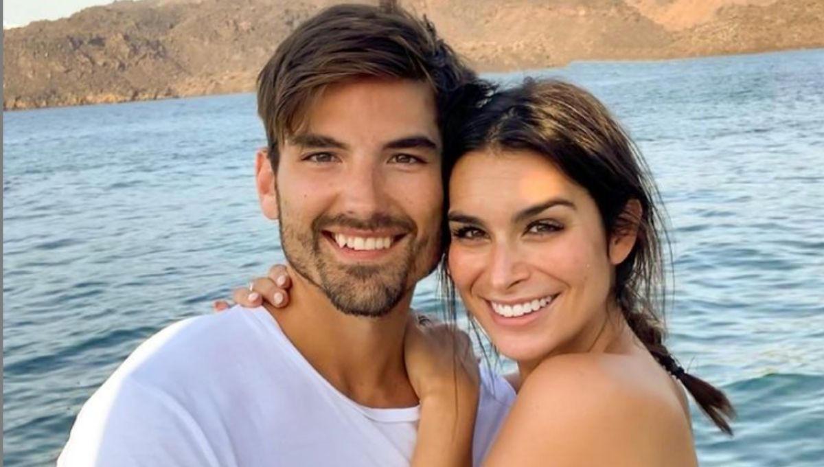 Ashley Iaconetti and Jared Haibon cuddle together in front of the water