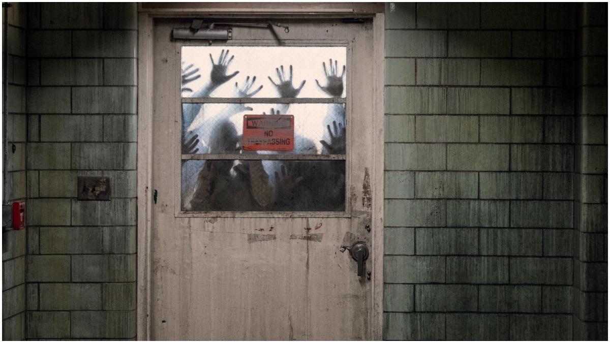 Walkers at the door, as seen in Episode 16 of AMC's The Walking Dead Season 10