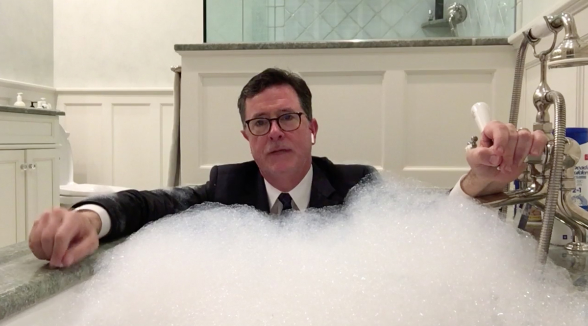 Stephen Colbert hosting the show from a bathtub