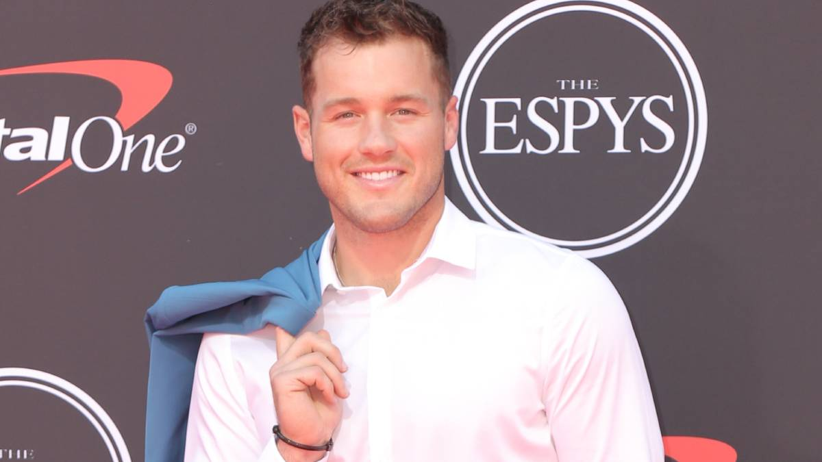 Colton Underwood poses on the red carpet