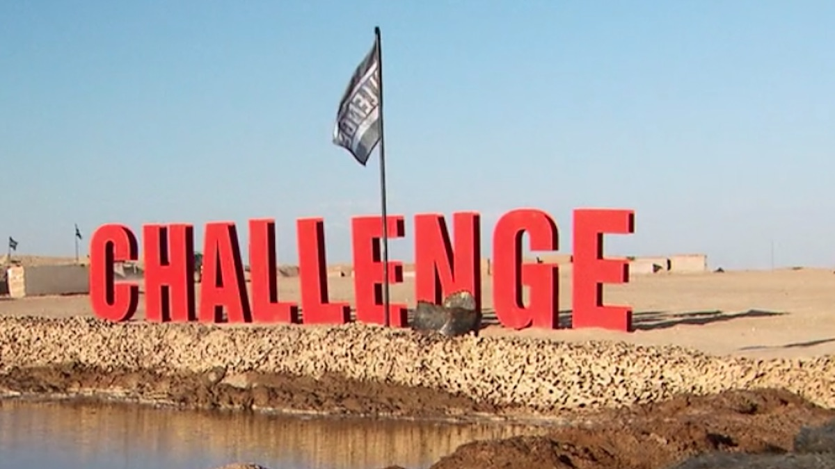 the challenge war of the worlds sign and flag on location for season 33