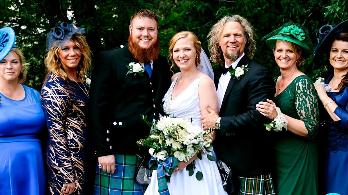 Aspyn and Mitch Thompson on their wedding day with Kody Brown and his wives from Sister Wives on TLC