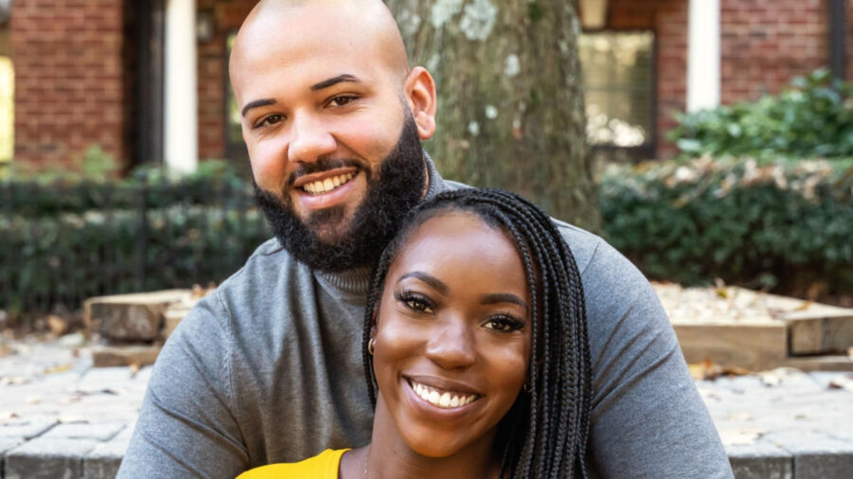 Vincent and Briana smile at the camera in promo picture