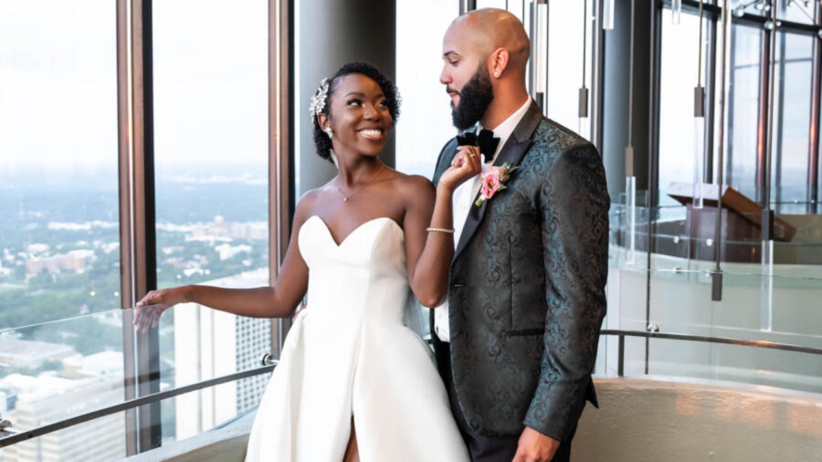 MAFS's Briana and Vincent smile at each other on their wedding day