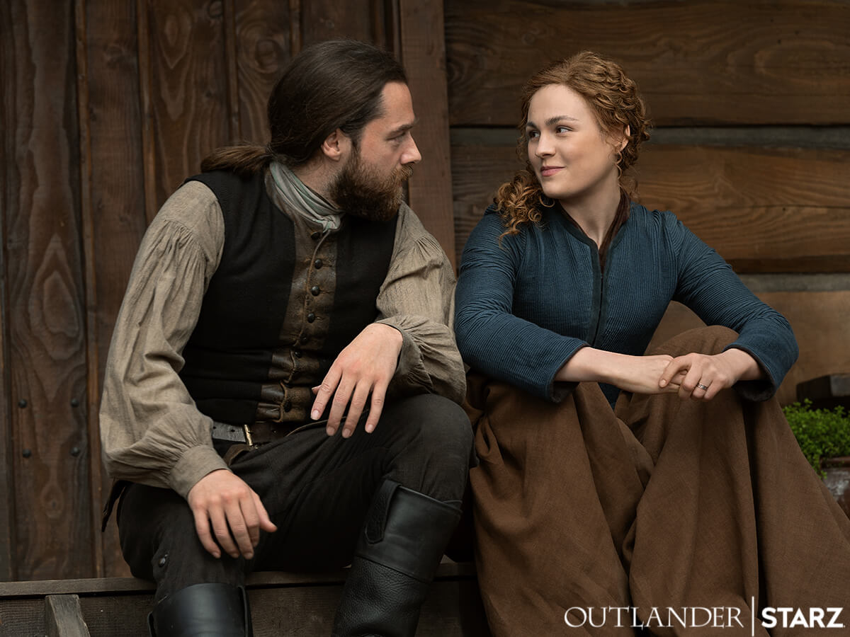 Richard Rankin as Roger Mackenzie and Sophie Skelton as his wife, Brianna, as seen in Season 6 of Starz's Outlander