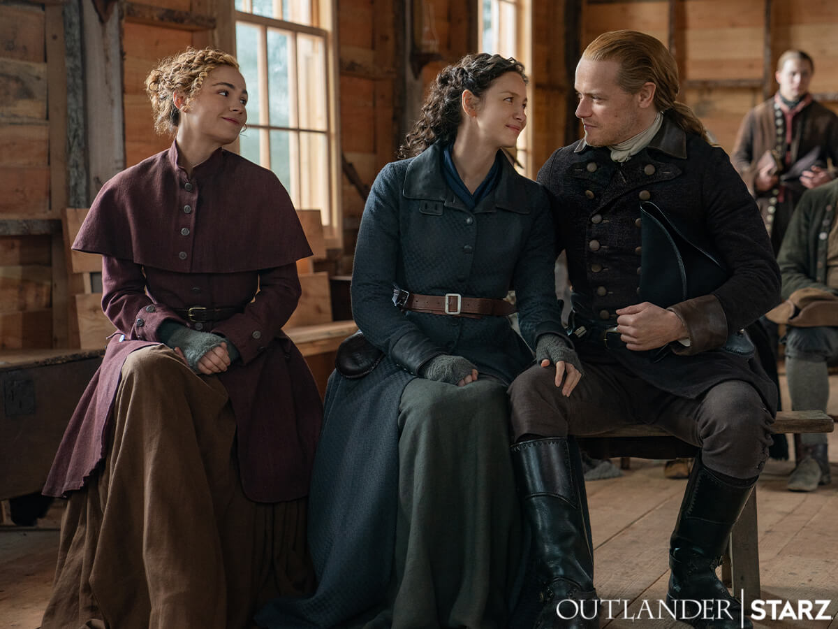 Sophie Skelton as Brianna, Caitriona Balfe as Claire, and Sam Heughan as Jamie, as seen in Season 6 of Starz's Outlander