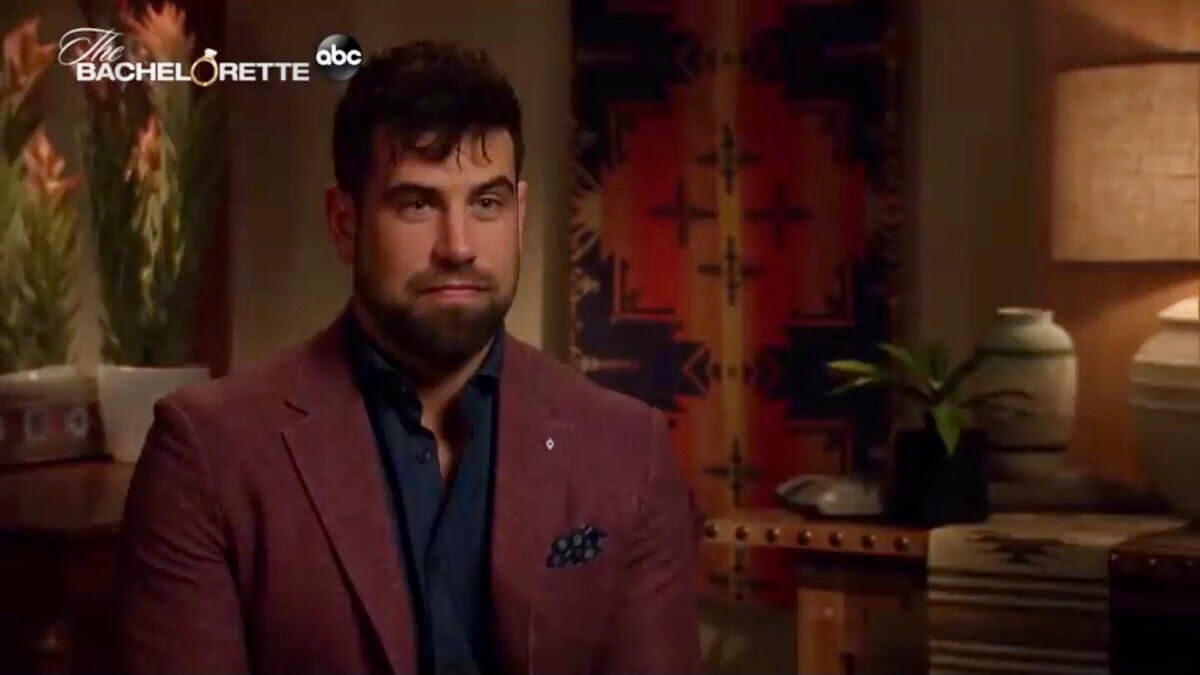 Blake Moynes wheres a burgundy suit in his confessional on The Bachelorette