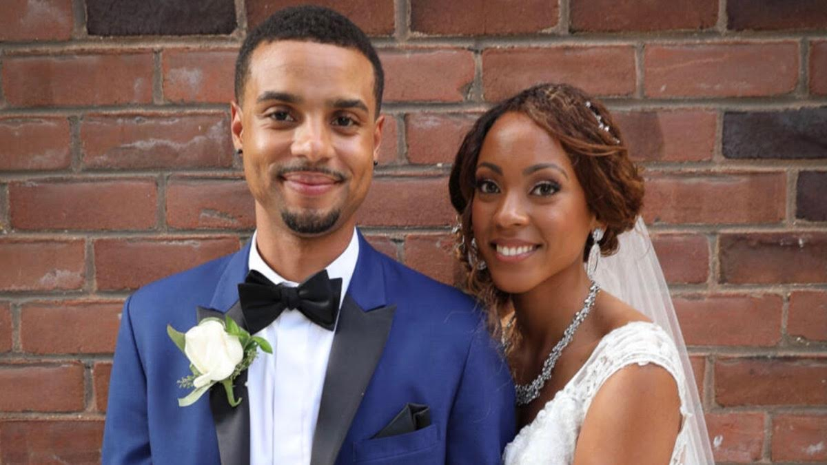Brandon and Taylor pose with a smile on their wedding day