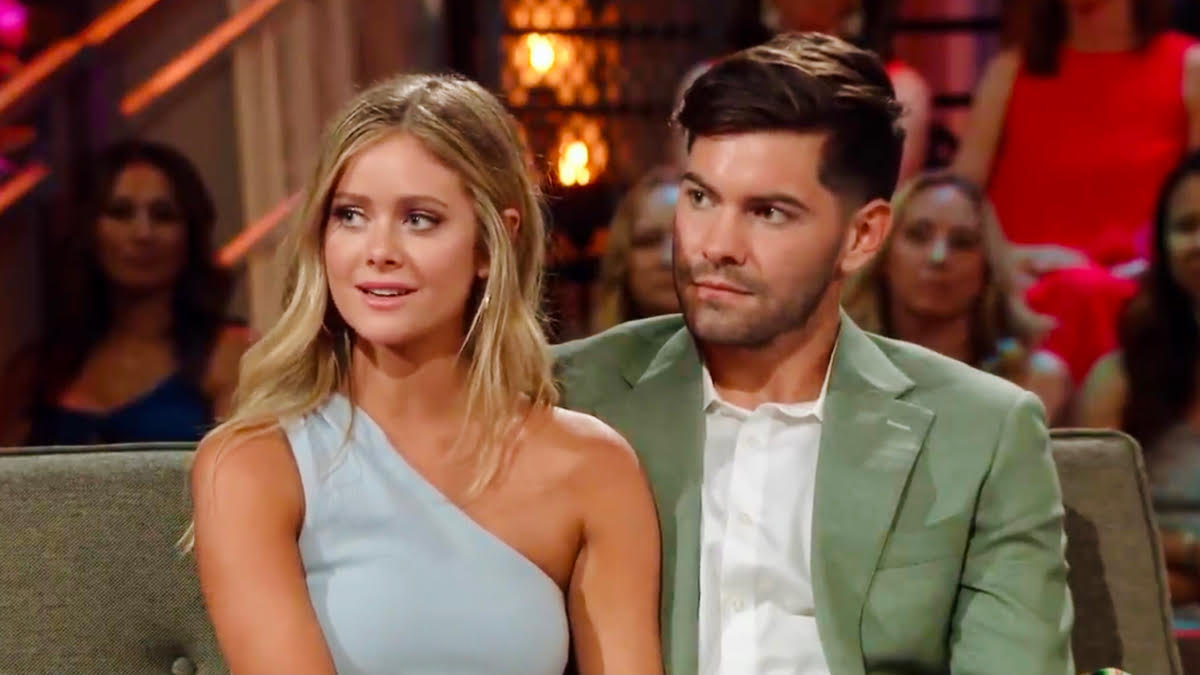 Hannah Godwin and Dylan Barbour sit together on the couch during the Bachelor in Paradise Season 6 reunion