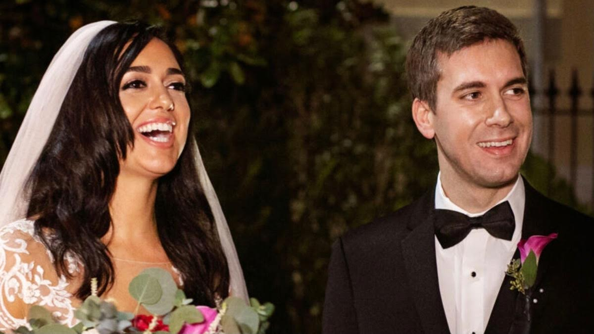 Henry and Christina share a laugh on their wedding day
