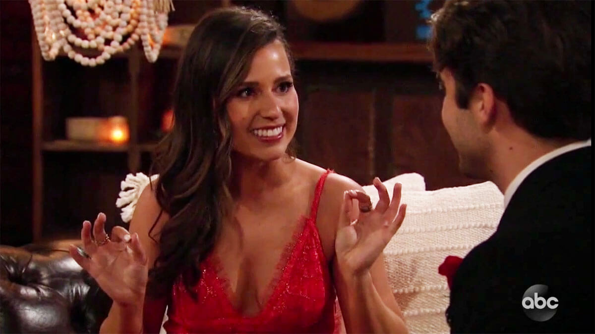 The Bachelorette Katie Thurston smiling at Greg giving him first impression rose on premiere episode