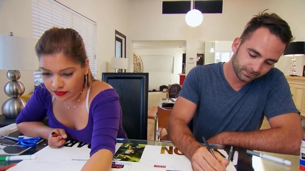 Lillian and Tom work on a craft together in their home