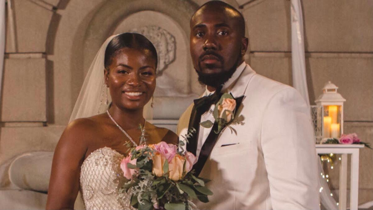 Meka and Michael pose on their wedding day