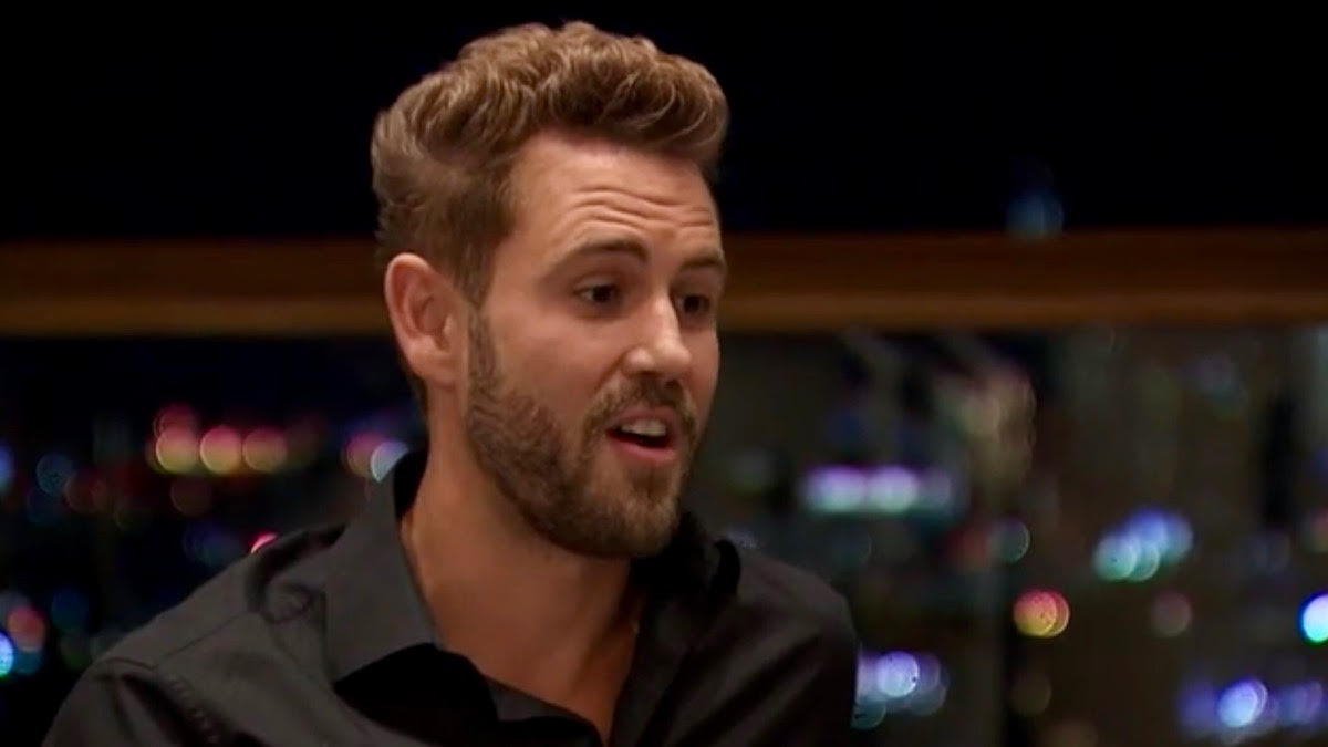 Nick Viall looks surprised at night in New York