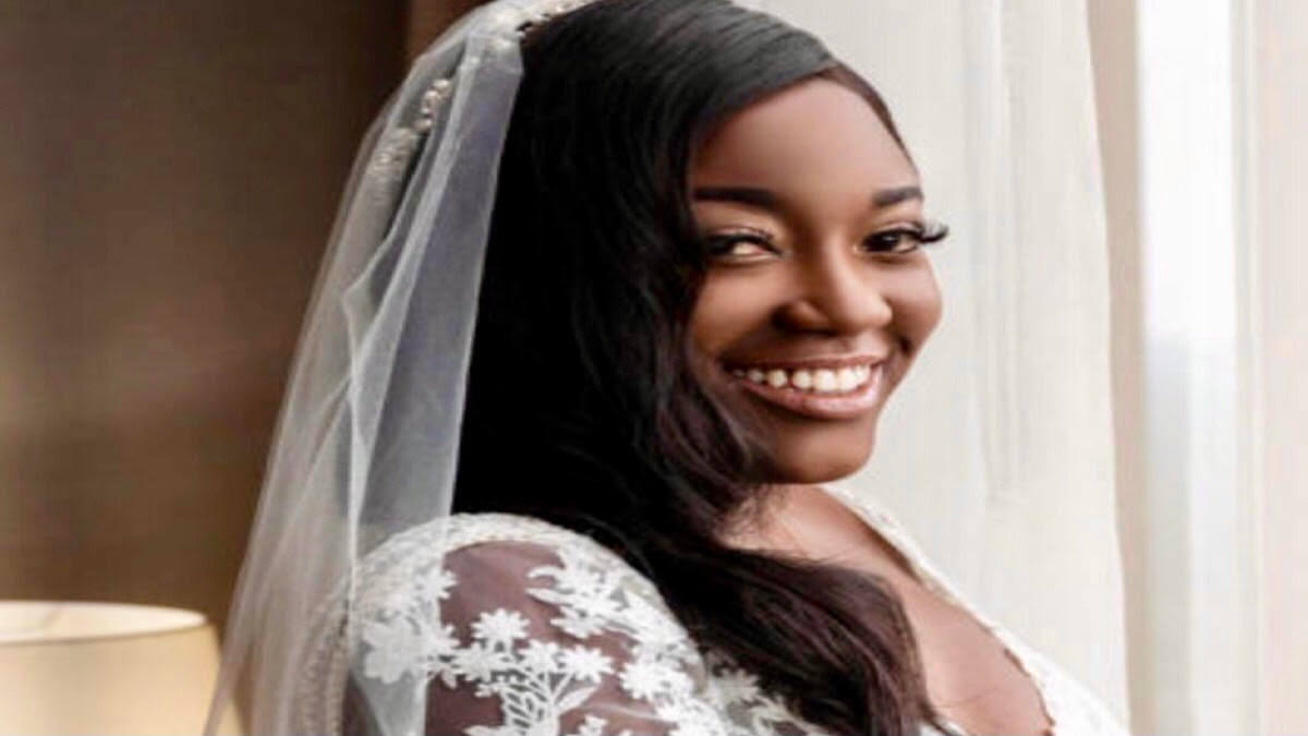 Married at First Sight star, Paige, poses with a smile in her wedding gown on her wedding day