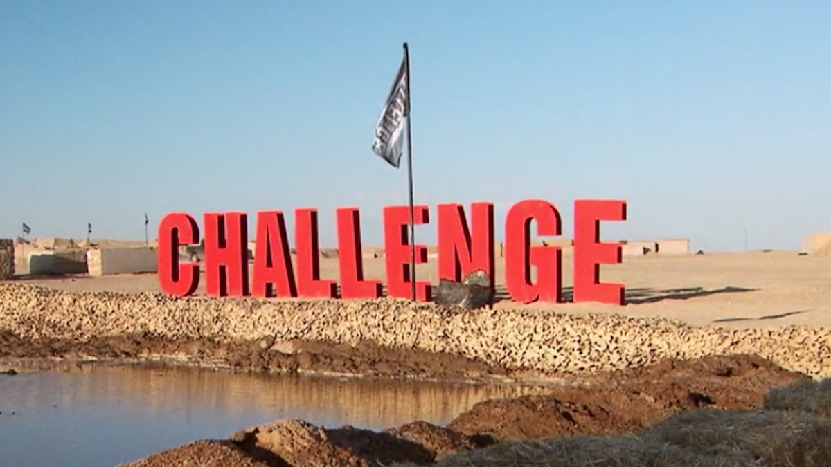 the challenge season 33 sign with flag on location of daily event