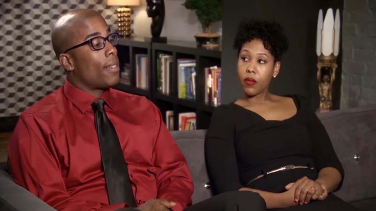 Vaughn and Monet wear black and red and sit on the couch