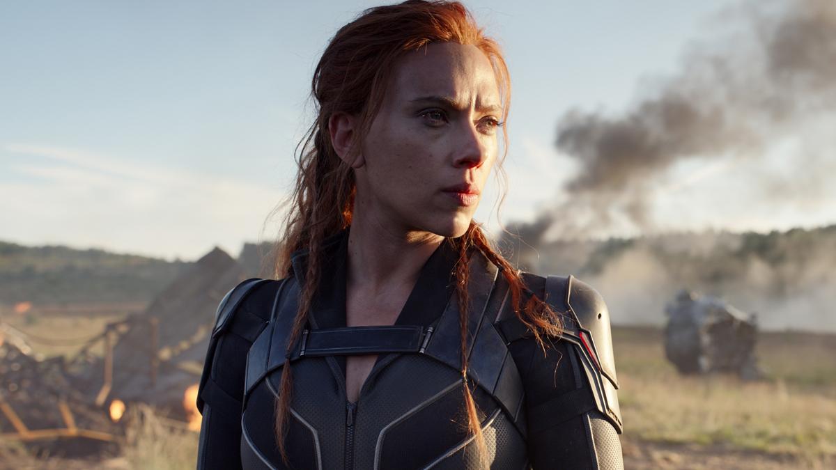 Black Widow standing in a field