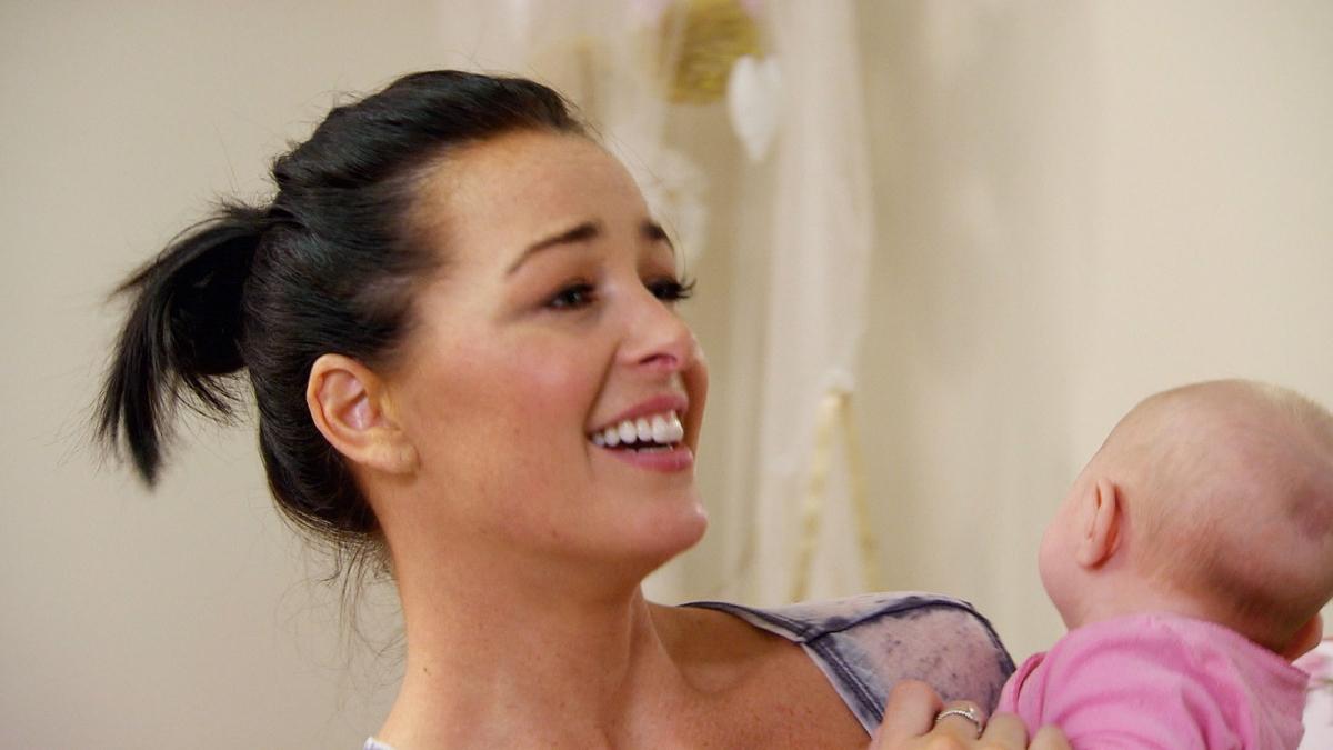Jamie Otis smiles with baby daughter Henley