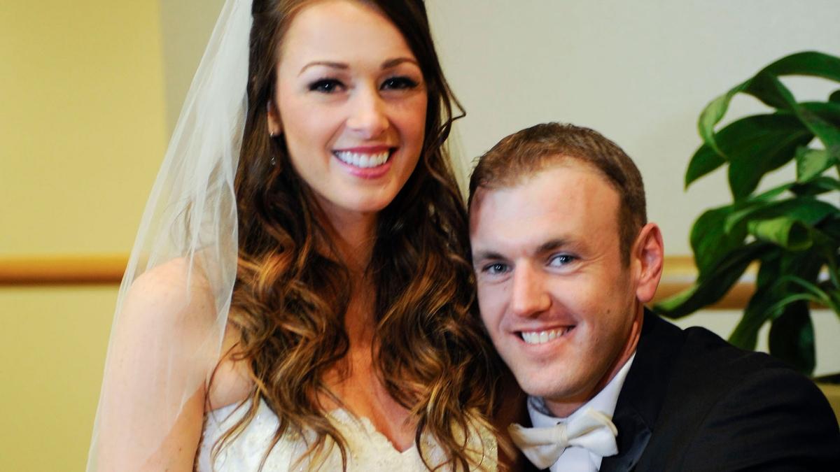 Jamie and Doug Otis smile on their wedding day