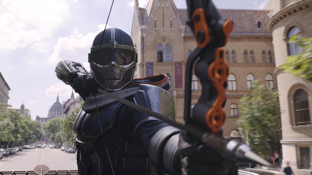 Taskmaster firing an arrow at Black Widow