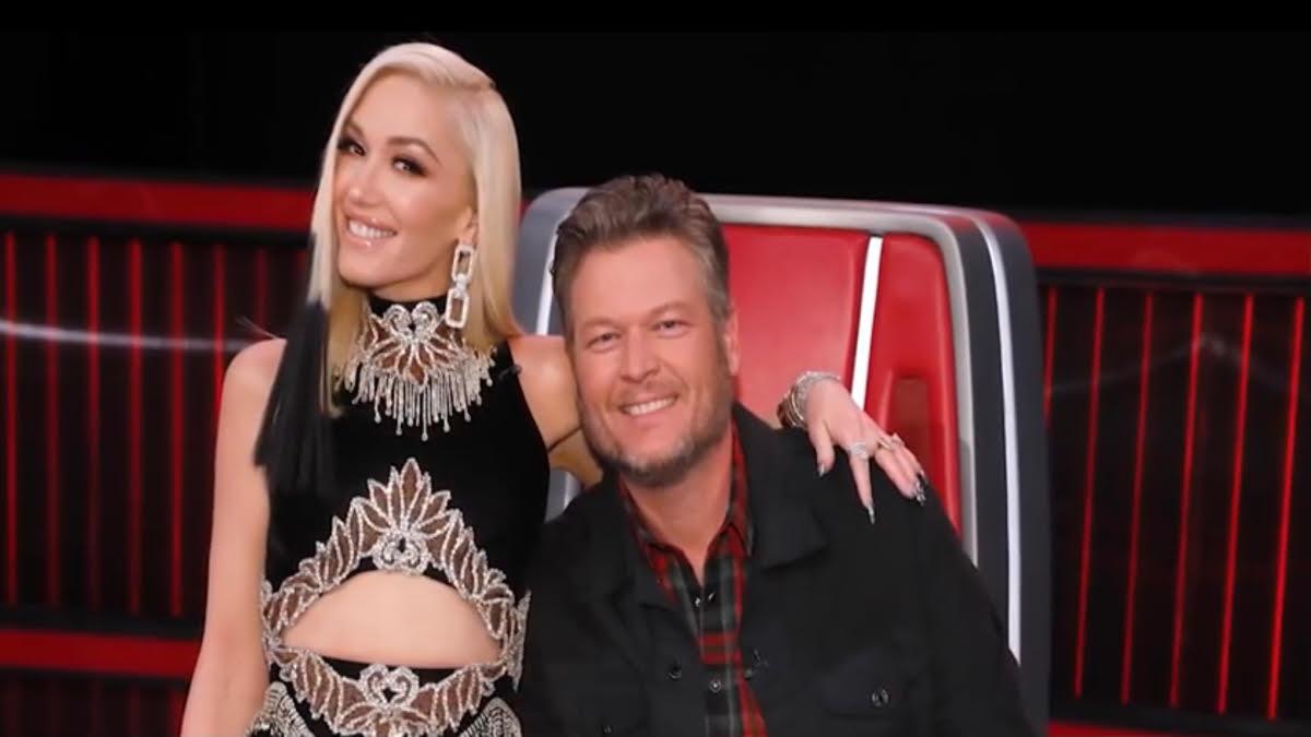 Gwen Stefani sits on Blake Shelton's lap