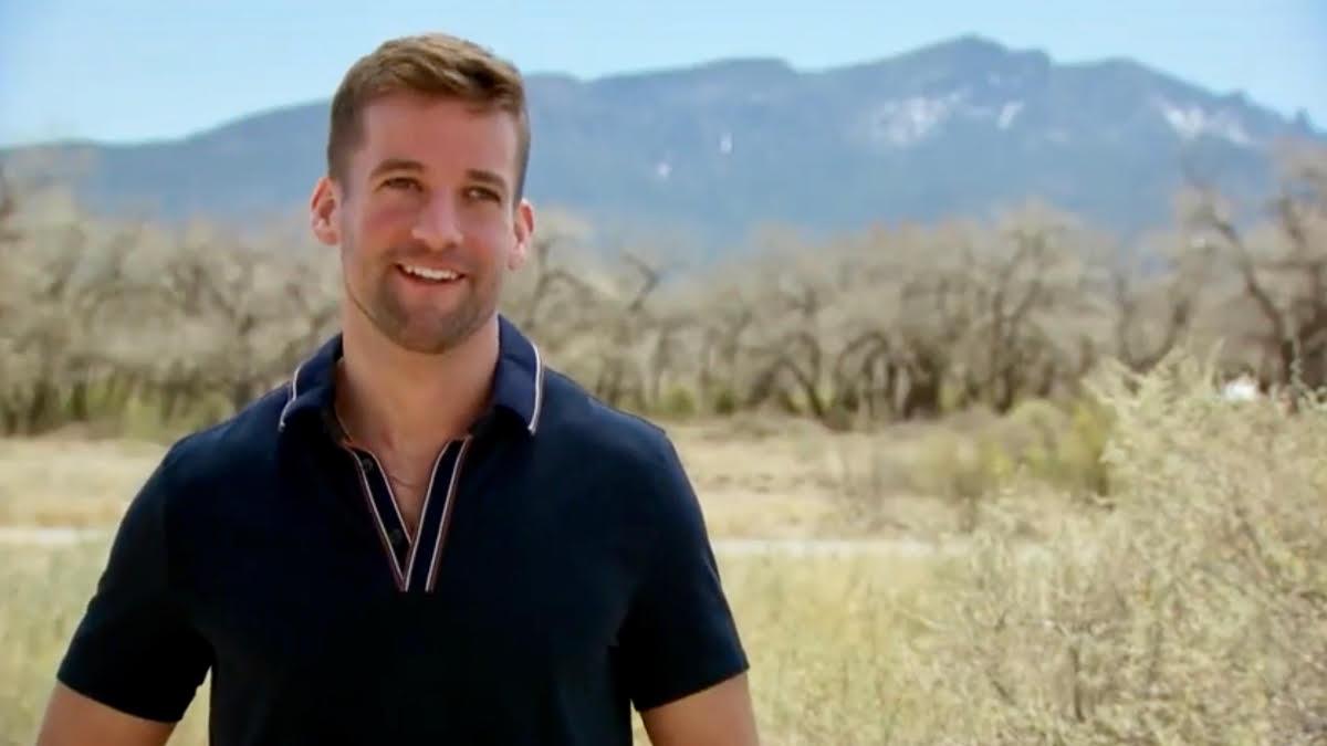 Connor Brennan smiles outdoors